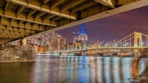 picture of downtown pittsburgh from under a bridge